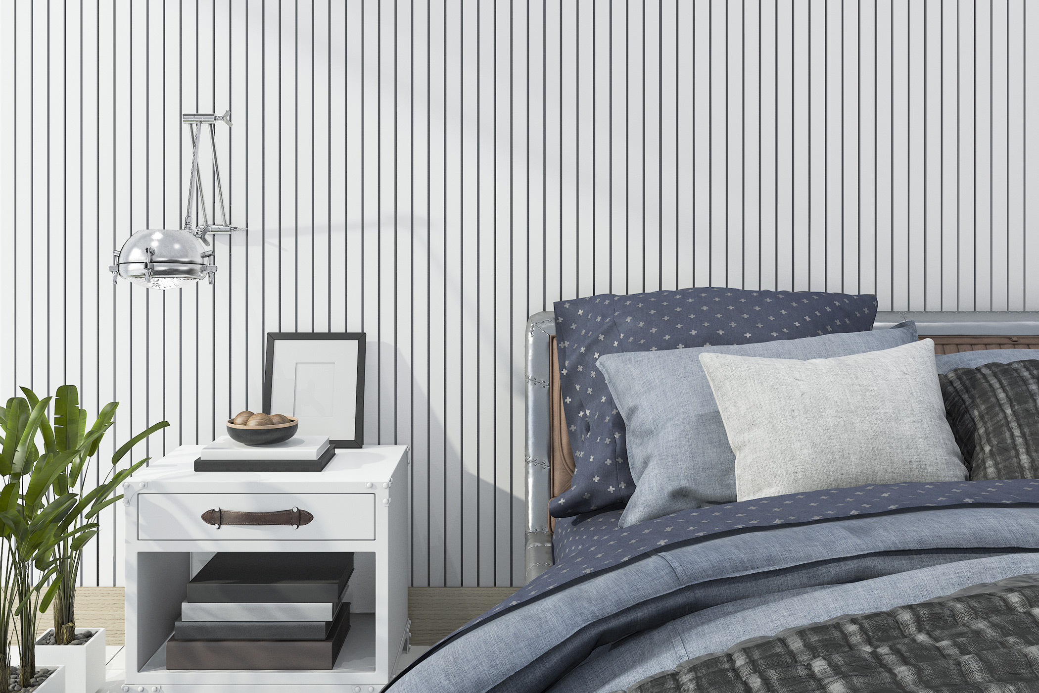a bed and side table decorated neatly in front of the bold vertical striped wallpaper