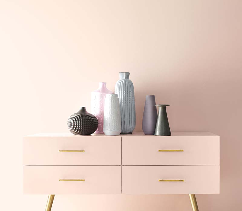 a wall and an end table painted in Benjamin Moore Colour of the year 2020 First Light